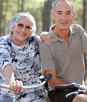 Senior couple enjoying outdoor activities/living options at the best nursing home in friendswood tx